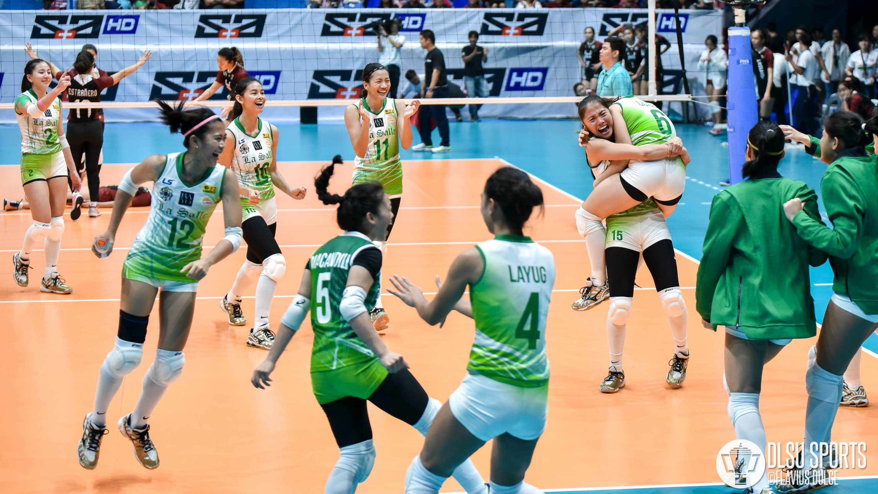 The DLSU Lady Spikers celebrate their win over UP after setter Michelle Cobb aced three straight services to complete their Set 3 comeback.